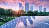 Ecological energy renewable solar panel plant with urban landscape landmarks in sunset poster