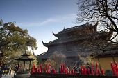 HANGZHOU, CHINA - NOVEMBER 26: Red candles fill the altar at the Mahavira Hall, Lingyin Temple on No