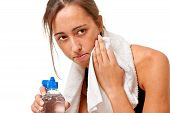 Sports Woman Resting And Cleaning Her Face