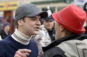 An Exeter English Defence League member remonstrates with a woman