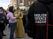 A woman dressed in a burka defies and confronts the English Defence League,