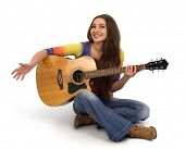 Girl with guitar and long hair on a white background