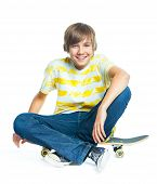 blond boy on sitting on skateboard