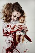 Halloween Theme Girl Child Zombie or Ghost covered in blood holding knife and baby doll.
