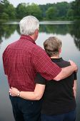 image of senior-citizen  - Senior couple enjoying the outdoors by the lake - JPG