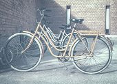 Vintage Style Of A Women Bicycle Parked In A Cycle Stand. Cycling Or Commuting In City Urban. poster