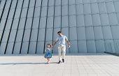 Young Family With Little Daughter Walking Near The Modern Building In High-tech Architecture Style.  poster