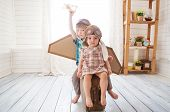Happy Children Playing With Vintage Wooden Airplane. Kids Having Fun At Home. Imagination And Freedo poster