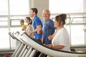 Happy Senior Man Enjoying His Time In Fitness Club. Portrait Of Elderly Man On Treadmill Looking At  poster