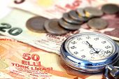 stock photo of turkish lira  - Chronometer and turkish liras bills close up shallow dof - JPG