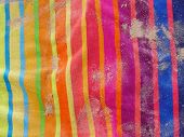 Colourful beach towel with sand