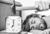 Annoying Ringing Alarm Clock. Man Bearded Annoyed Sleepy Face Lay Pillow Near Alarm Clock. Guy Knock poster