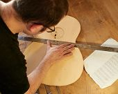 Marking And Pasting Of Footer And Brace To The Soundboard Of A Classical Guitar. Production Of Class poster