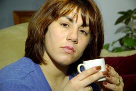 image of ordinary woman  - woman holding a coffee mug - JPG
