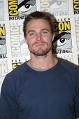 SAN DIEGO, CA - JULY 13: Stephen Amell arrives at the 2012 Comic Con convention press room at the Ba