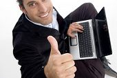 Handsome Accountant Working On Laptop Gesturing Thumbs Up