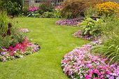 stock photo of cultivation  - A beautifully manicured yard with a garden full of perennials and annuals - JPG