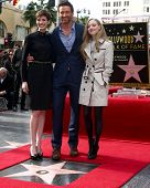 LOS ANGELES - DEC 13:  Anne Hathaway, Hugh Jackman, Amanda Seyfried at the Hollywood Walk of Fame ce