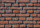 Weathered red brick wall texture. Seamlessly. Tileable
