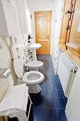 pic of shower-cubicle  - a white interior of narrow lavatory room - JPG