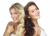 portrait of two attractive  caucasian smiling women blond isolated on white studio shot  toothy smil