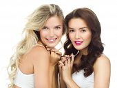 portrait of two attractive  caucasian smiling women blond  and brunette isolated on white studio sho