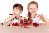Two Little Girls With A Full Bowl Of Cherry