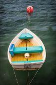 Fiberglass dory moored in quiet water.