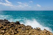 Limestone Coastline And Ocean Horizon Background