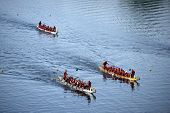 HARTFORD - AUGUST 17: Racers participate in a dragon boat race during the annual Riverfront Dragon B