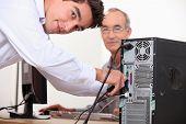 Computer technician repairing PC