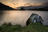 Stunning Mountain And Lake Sunrise Reflections Beautiful Landscape With Rock In Foreground