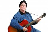 Guitarist undergoing chemotherapy treatment for cancer, wearing a turban to cover her hair loss.  Isolated on white.