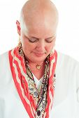 Cancer survivor has lost her hair as a result of chemotherapy.  White background.