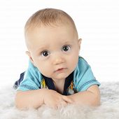 Close-up image of a beautiful, wide-eyed 3-month-old baby boy.  On a white background.