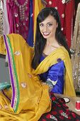picture of dupatta  - Portrait of an Indian female dressmaker holding sari - JPG