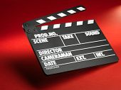 stock photo of clapper board  - Clapper board on red background - JPG