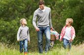 image of 7-year-old  - Father Taking Children On Picnic In Countryside - JPG