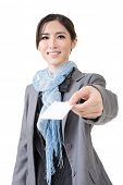 Asian business woman hold a blank business card, cutaway. Close up portrait on the white background.