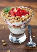Fresh Strawberry and yogurt parfait with granola.