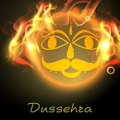 Indian festival Dussehra concept with illustration of Ravana face in flame.