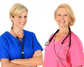 Two friendly nurses in uniform with stethoscope.