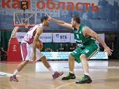 pic of unicity  - SAMARA RUSSIA - DECEMBER 02: Chester Simmons of BC Krasnye Krylia with ball goes against a BC UNICS player on December 02 2012 in Samara Russia.