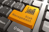 stock photo of risk  - Orange Risk Management Button on Computer Keyboard - JPG