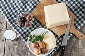 stock photo of ouzo  - Delicious Cheese and olives on table close up - JPG