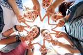 stock photo of hand gesture  - summer holidays and teenage concept  - JPG