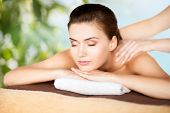 beauty, holidays and spa concept - woman in spa salon getting massage