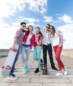 stock photo of skate  - summer holidays and teenage concept  - JPG