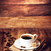 Cup Of Coffee With Coffee Beans On A Beautiful Wooden  Brown Background In Rustic Style With Copyspa
