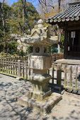 Japanese Traditional Stone Lantern In Kotokuin (great Buddha) Temple